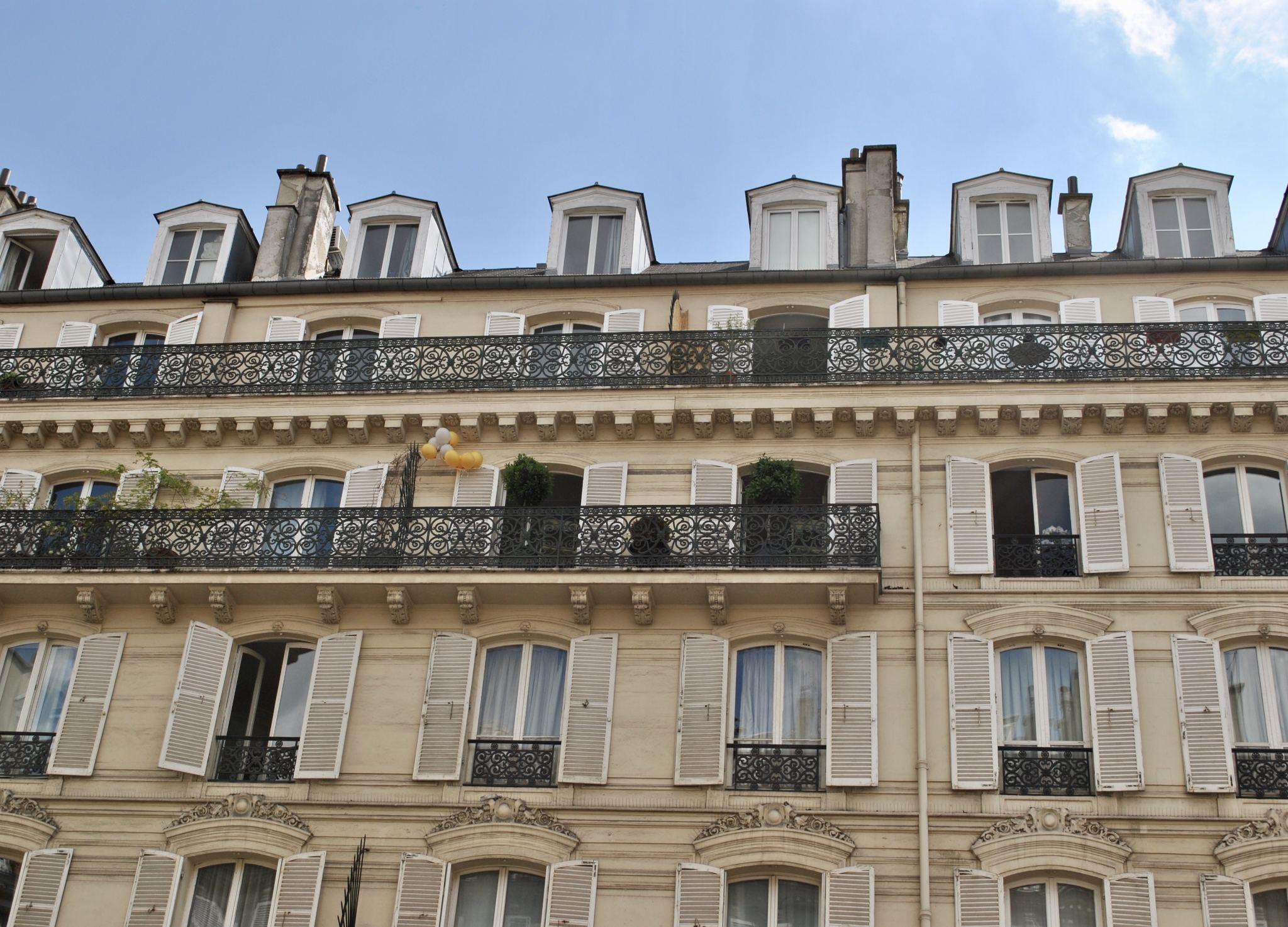 Window shutters and pretty balconies